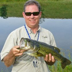 Chris Hunter with a bass captured at Dickinson Cattle Co Saturday morning at 9:30